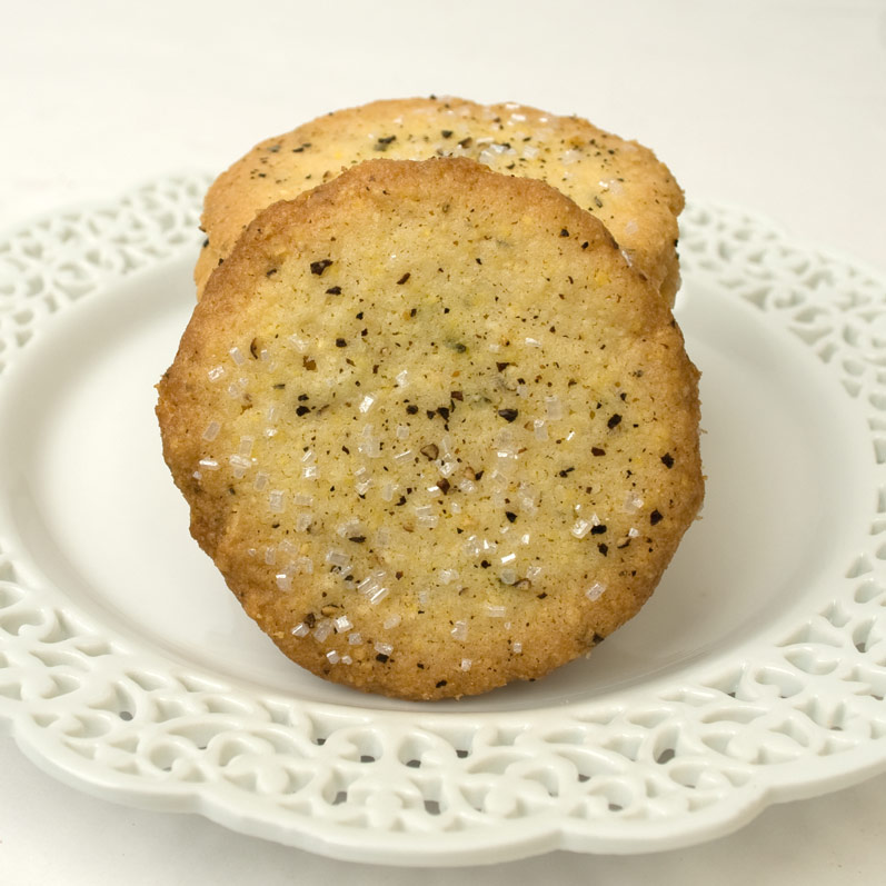 Stack of Cornmeal, Black Pepper & Rosemary Butter Cookies on a Plate