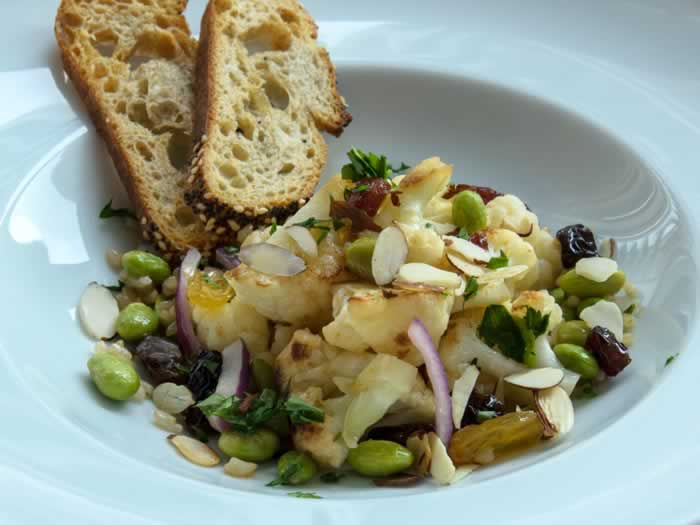 Warm Cauliflower, Edamame & Raisin Salad